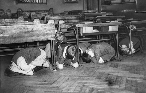 6-Taking-Cover-During-An-Air-Raid-Drill-1940